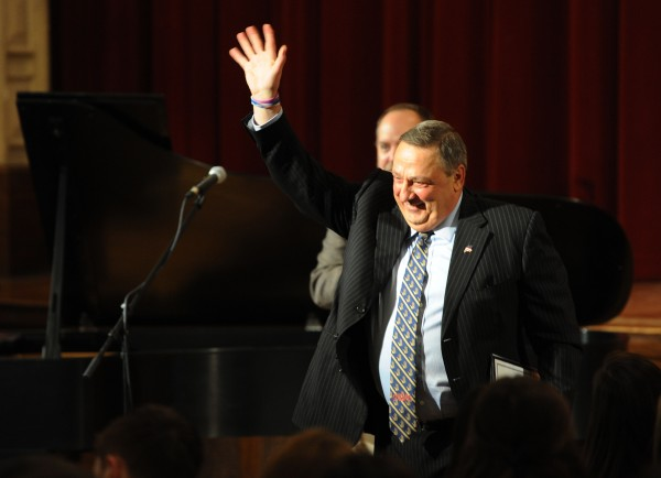 Gov. Paul LePage leaves a packed auditorium at John Bapst High School on Dec. 6, 2013, after speaking about domestic violence.