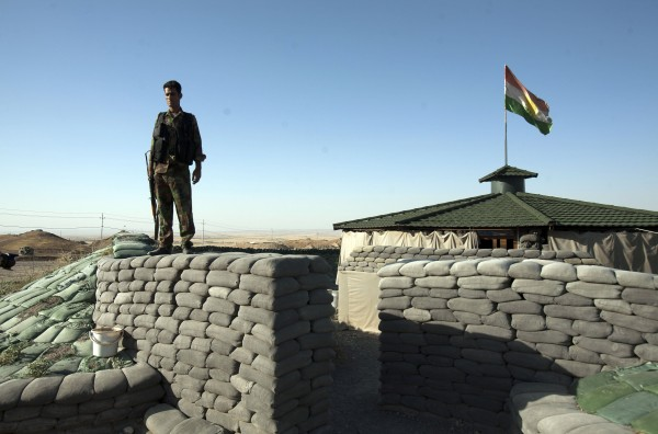 Kurdish Peshmerga fighters along a front-line position protect the main highway between Kurdish occupied Kirkuk and the capital of the Kurdish Regional Government in Arbil.