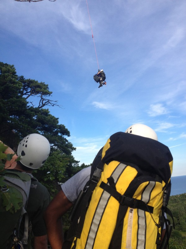 A stranded hiker in need of medical attention is lifted off Beehive Mountain in Acadia National Park on Wednesday.