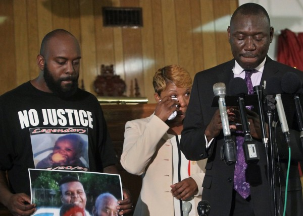 Michael Brown Sr. and Lesley McSpadden, parents of Michael Brown, said that they want justice on Monday afternoon, Aug. 11, 2014, in Jennings, Mo. at a press conference at the Jennings Mason Temple Church of God in Christ. With them is their lawyer, Benjamin Crump.