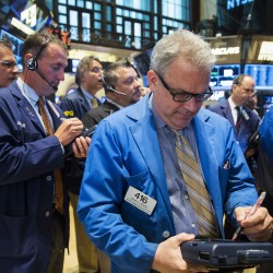 Wall Street ends flat on late buying, Cyprus woes linger