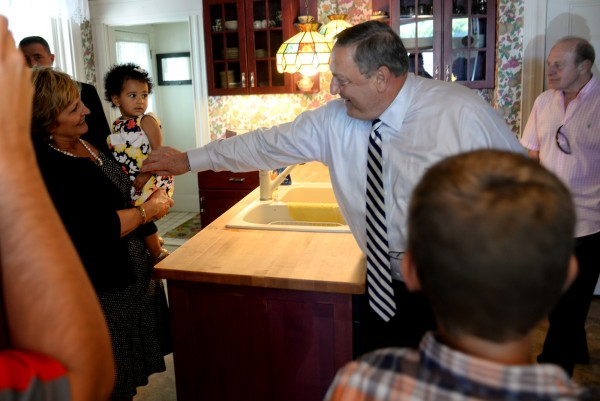 Gov. Paul LePage says hi to 11-month-old Jazmyn Kocak, being held by first lady Ann LePage, while visiting the Shepherd's Godparent Home in Bangor on Monday afternoon.  The governor and first Lady took a tour of the residential maternity home for women in crisis ages 13-28.
