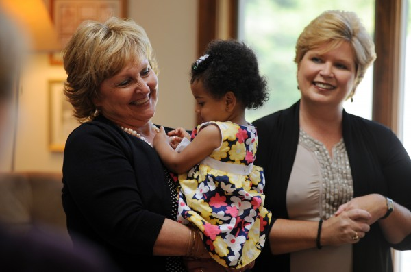 First lady Ann LePage holds 11-month-old Jazmyn Kocak while visiting the Shepherd's Godparent Home in Bangor with the governor on Monday afternoon. Director Barbara Ford (right) took Gov. Paul LePage and the first lady through the residential maternity home for women in crisis ages 13-28.