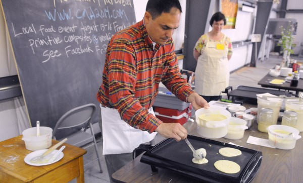 The Rev. Paul Dumais demonstrates making ployes using several different recipes during the Kneading Conference in Skowhegan on Friday, July 25, 2014.