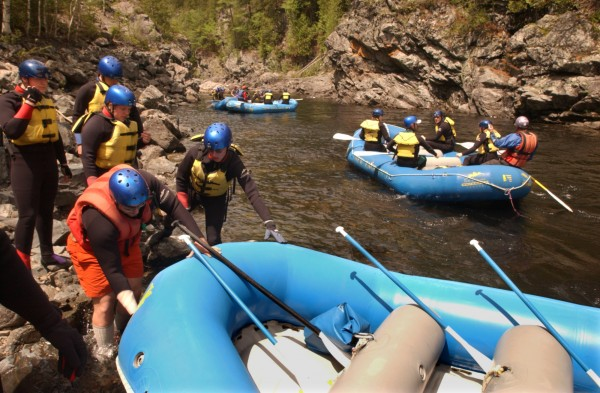 Rafts from Millinocket-based New England Outdoor Center get ready to head down the West Branch of the Penobscot River.