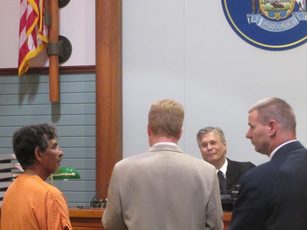 Nicandro Velasquez (left) made his initial court appearance Monday in Rockland District Court. Standing with him in front of Judge Patrick Ende is attorney James Mason and Jeff Lord (right), a court marshal.