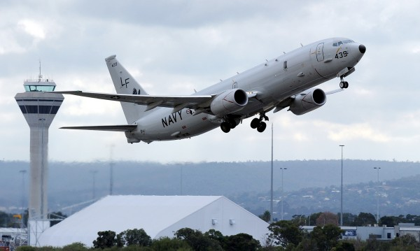 A U.S. Navy P-8 Poseidon aircraft takes off from Perth International Airport in this April 16, 2014 file photo. The United States has lodged a formal protest with Beijing over an air intercept this week in which a Chinese warplane flew close to a U.S. Navy patrol jet and conducted acrobatic maneuvers around it in international air space, the Pentagon said on Aug. 22, 2014. Rear Admiral John Kirby, the Pentagon press secretary, said the intercept took place on Aug. 19, 2014, 135 miles (200 km) east of Hainan Island. He said the Chinese fighter jet flew as close as 20 to 30 feet (7 to 10 meters) to a P-8 Poseidon maritime patrol plane and conducted a barrel roll over the plane. Picture taken April 16, 2014.
