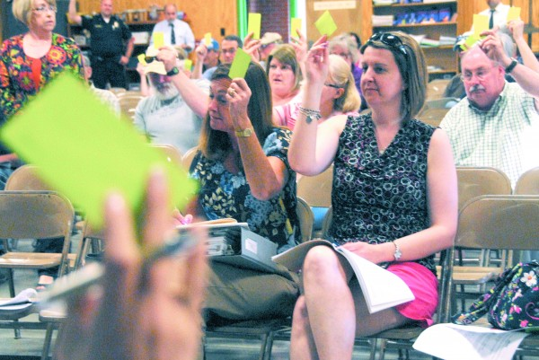 Residents vote at East Millinocket's annual town meeting in this June 2014 file photo.