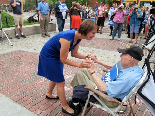 Democratic U.S. Senate candidate Shenna Bellows greets her grandfather, World War II veteran William Bellows, at a campaign event in Portland's Monument Square early Tuesday afternoon.