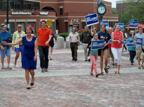 Democratic U.S. Senate candidate Shenna Bellows, who completed her 350-mile campaign walk from Houlton to Kittery earlier in the day Tuesday, approaches Monument Square in Portland for a rally to recap her travels.