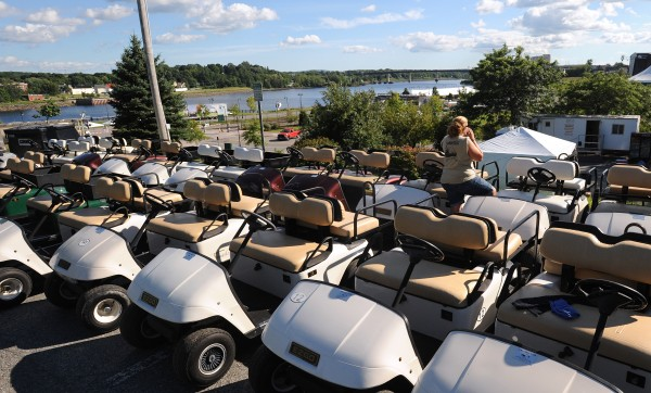 Golf carts and other support equipment lined up in  preparation for the 2014 American Folk Festival on the Bangor Waterfront.