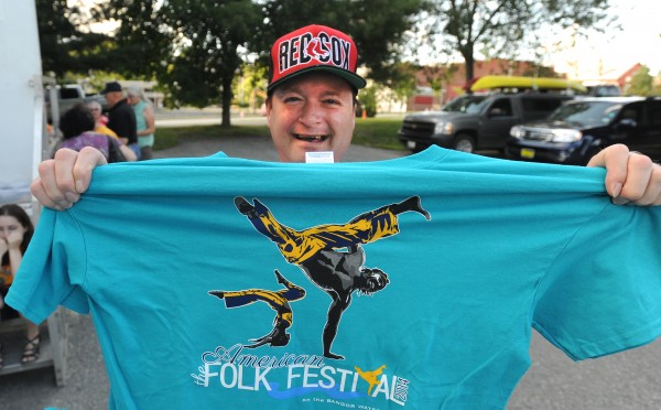 Robert Morris of Bangor proudly shows off the T-shirt he received when he signed up to volunteer during the 2014 American Folk Festival in Bangor.