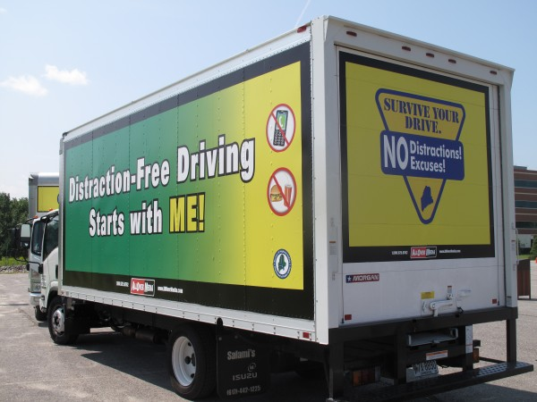 The state has contracted with three Maine trucking companies to place anti-distracted driving billboards on the side and rear panels of large commercial box trucks that travel within the state.