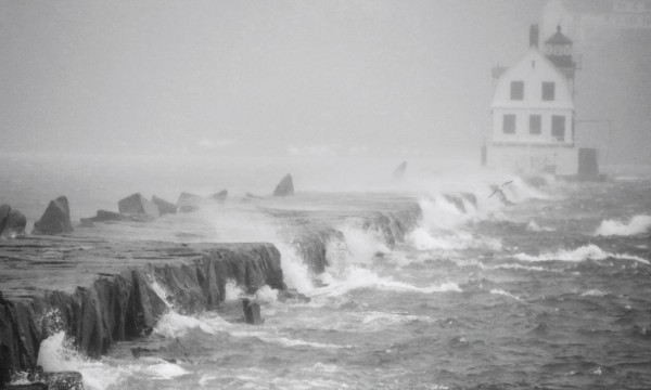 Waves from inside Rockland harbor crash into the Rockland Breakwater last year.