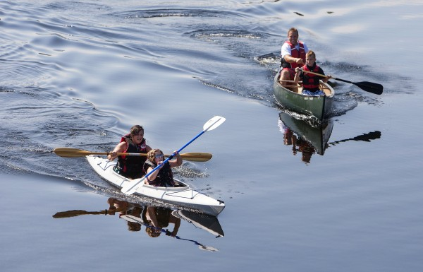 Canoers and kayakers make their way to Solider Pond for the Saucier family reunion in Wallagrass on Sunday as part of the 2014 World Acadian Congress.