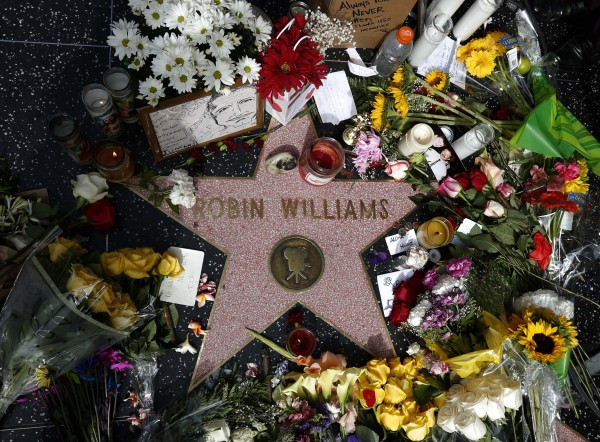 Flowers are seen on the late Robin Williams' star on the Hollywood Walk of Fame in Los Angeles, California, on Tuesday.