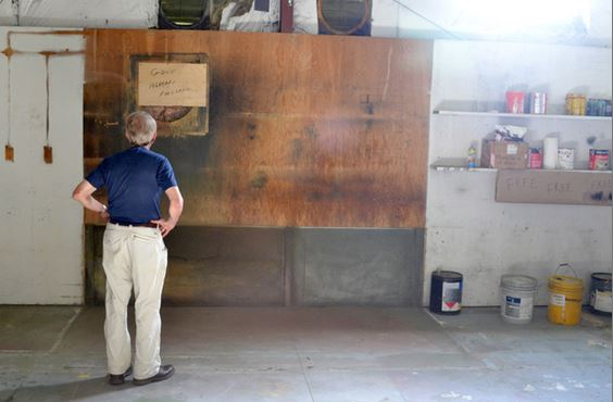 Rudy Graf, a longtime owner of The Science Source who sold the company in 2011, looks at a message recently scrawled on a piece of plywood on the wall of the company's now-former paint shop: &quotGone ...  already forgotten...&quot