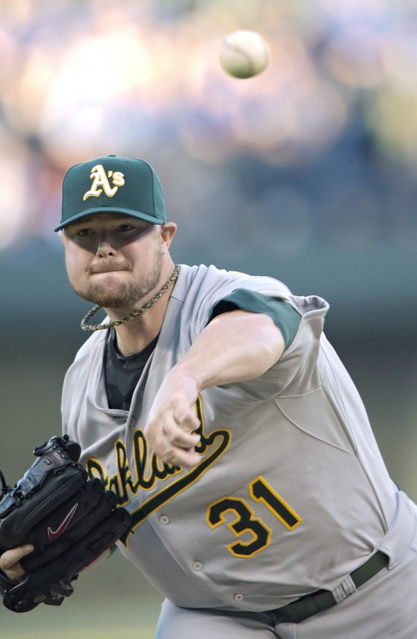 Oakland Athletics starting pitcher Jon Lester throws against the Kansas City Royals on Tuesday.