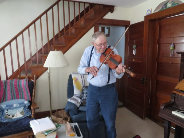 After retiring from boat building, Ralph Stanley began building and playing fiddles.