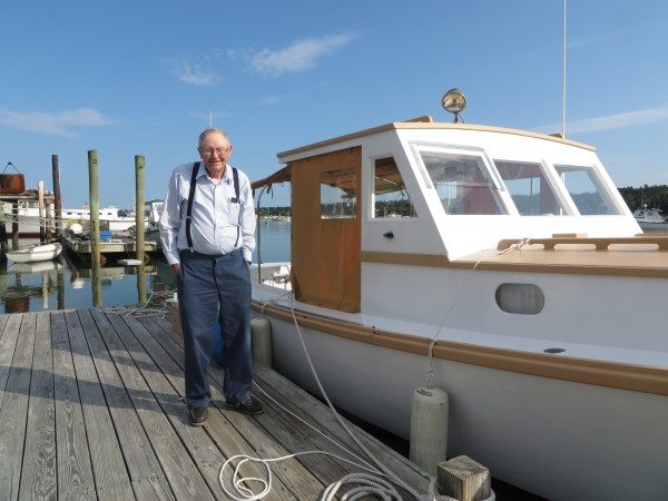 Ralph Stanley stands beside the boat he built for his father in 1960, &quotSeven Girls,&quot named for Ralph's seven sisters.