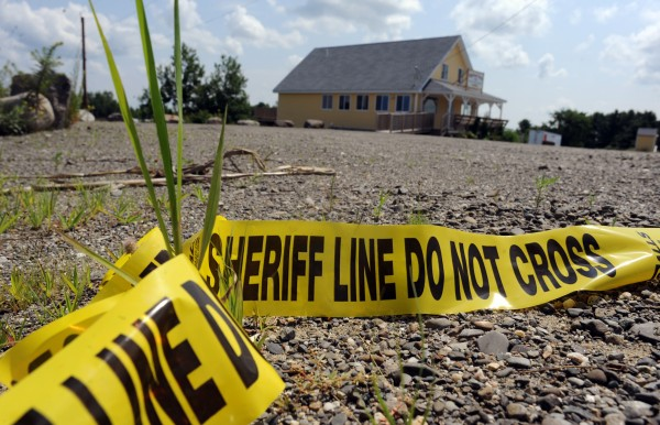 A three-hour standoff ended Sunday night when a Maine state trooper shot and killed Lewis Conlogue outside the former Highland Farm Restaurant in LaGrange.