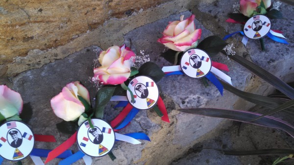 Flowers laid at the base of a memorial to Onias Martin in Bonnetable, France, during a ceremony commemorating the 70th anniversary of his death in WWII.