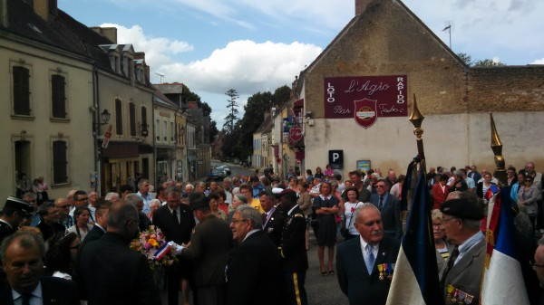 Residents, public officials and military representatives gather in downtown Bonnetable, France, for a ceremony recognizing the sacrifices of liberation forces 70 years ago.