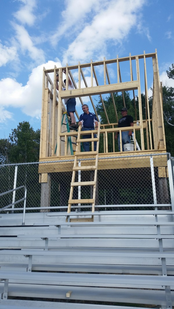 Masons from Monument Lodge No. 96 of Houlton erect a press box at the Maliseet Sports Complex where the Houlton High School football team will play its home games beginning this season. The Masons are doing the work on a volunteer basis as part of their annual community betterment project.