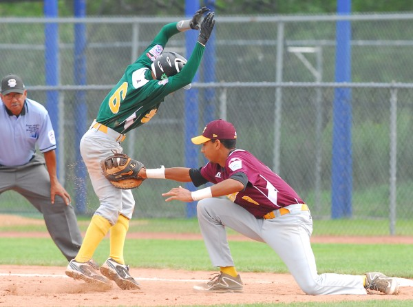 Latin America's Riordan Windster is caught off first base and tagged out by by U.S. Southeast's Christian Colangelo during a Senior League World Series semifinal at Mansfield Stadium in Bangor, Maine Friday.