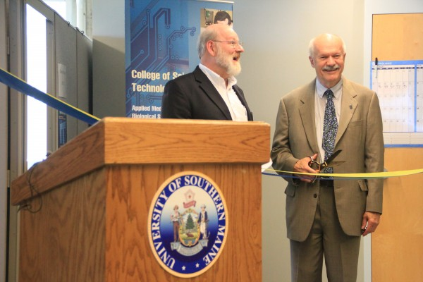 Glenn Wilson, director of the Maine Cyber Security Cluster, and new University of Southern Maine President David Flanagan commemorate the opening of the Portland campus's new cybersecurity lab Tuesday.