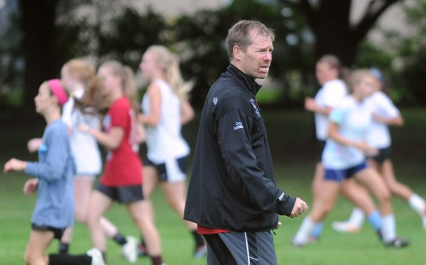 Bangor High School girls soccer coach Joe Johnston watches his team practice on Monday in Bangor.