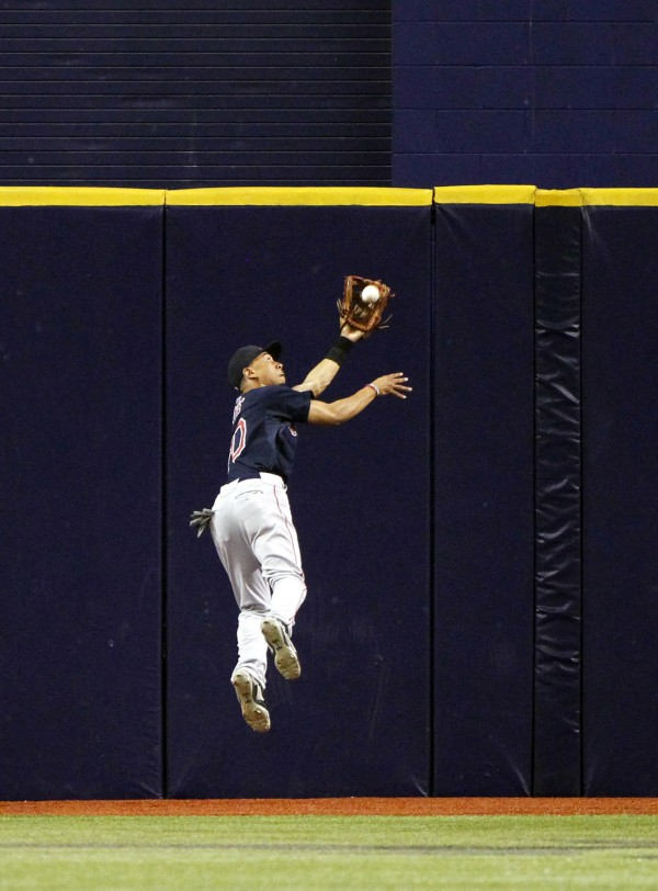 Boston Red Sox right fielder Mookie Betts catches a fly ball during the fifth inning against the Tampa Bay Rays at Tropicana Field in St. Petersburg, Florida, Friday night.