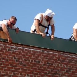 Worker falls through roof at Schenck High School during construction job