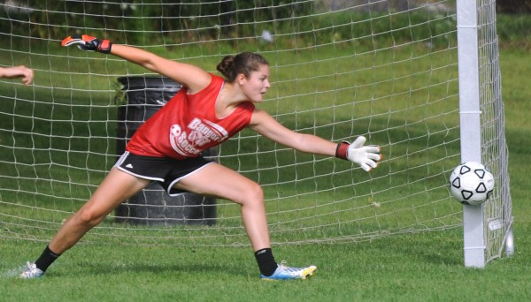 Bangor High School goalie Emily Gilmore makes a save during practice on Monday in Bangor.