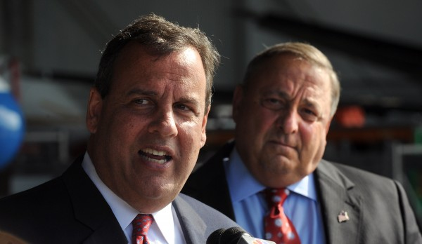 New Jersey Gov. Chris Christie and Maine Gov. Paul LePage speak during a press conference following a brief tour of C&L Aviation in Bangor.