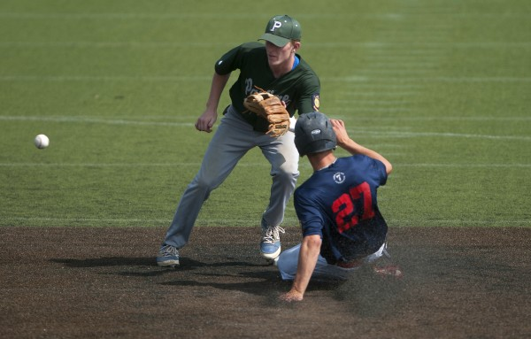 Post 51 of Oakland's Devon Warren (right) slides safely to second before Pastime Club of Lewiston's Matt Poulin can make the catch during their American Legion state baseball tournament game Friday at Husson University in Bangor.