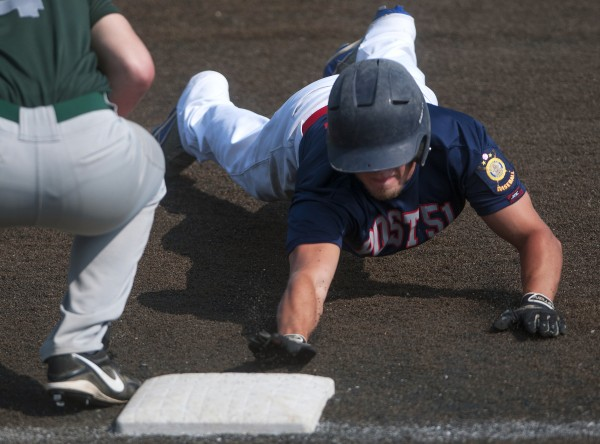 Post 51 of Oakland's Josh Woodard (right) slides safely past to first before Pastime Club of Lewiston's Carter Chabot can make the out during their American Legion state baseball tournament game Friday at Husson University in Bangor.