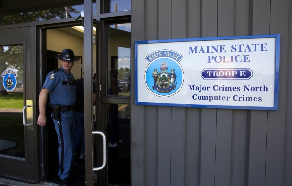 A Maine State Police officer exits the new state police barracks in Bangor on Wednesday.
