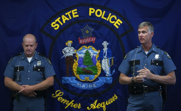 Maine State Police Col. Robert Williams (right) addresses the crowd while Maine State Police Lt. Wesley Hussey listens during the grand opening of the new state police barracks in Bangor on Wednesday.