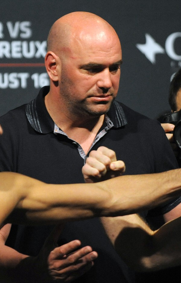 UFC President Dana White sets up a photo with two fighters during the weigh-ins on Friday at the Cross Insurance Center in Bangor.