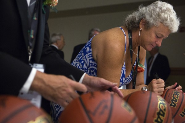 Inaugural class of the Maine Basketball Hall of Fame inductee Lisa Blais Manning signs a basketball before the induction ceremony Thursday at the Cross Insurance Center in Bangor.