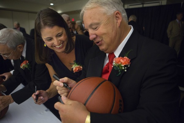 Joanne Palombo-McCallie (left) jokes with Paul Vachon while signing basketballs before they were inducted into the Maine Basketball Hall of Fame on Thursday at the Cross Insurance Center in Bangor.