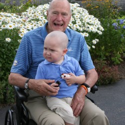 Former President George H.W. Bush shaves head to support toddler with leukemia