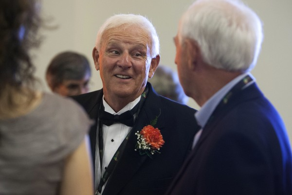 Skip Chappelle (center) chats with a friend during the inaugural class of the Maine Basketball Hall of Fame induction ceremony Thursday at the Cross Insurance Center in Bangor.