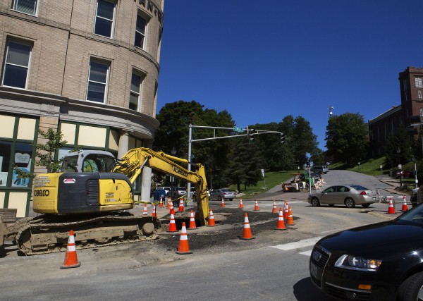 Cars navigate a construction site near the intersection of Central Street and Harlow Street in Bangor on Tuesday.