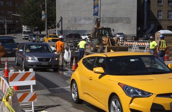 Cars navigate a construction site near the intersection of State Street and Exchange Street in Bangor on Tuesday.