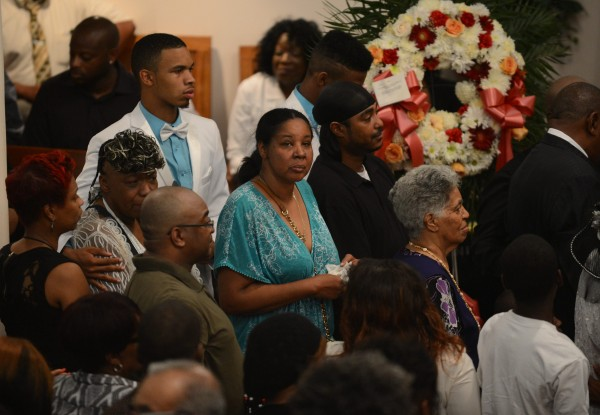 Esaw Garner, center, is shown during the funeral for her husband Eric Garner at Bethel Baptist Church in Brooklyn, New York July 23, 2014.