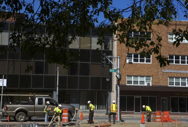 Construction crews work on West Market Square in Bangor on Tuesday.