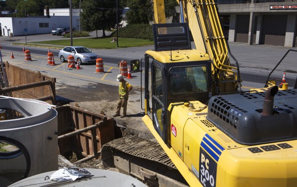 A car navigates a construction site near the intersection of Main Street and Cedar Street in Bangor on Tuesday.