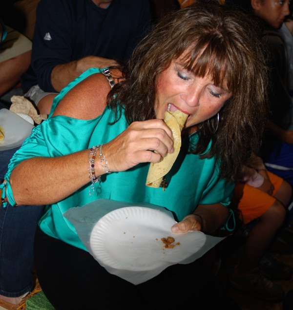 Carol Bowden samples her first ever ploye during Thursday's opening ceremonies of the Madawaska Acadian Festival, going on in conjunction with the 2014 World Acadian Congress.